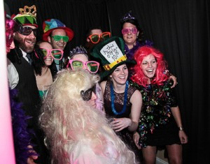 A group of people has Plenty of room for up to 35 people in the CKE Photo Booth.