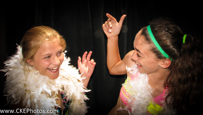 Several young happy 11 year-old's celebrate a birthday party inside the Curtis Knight Entertainment Photobooth in Billerica, MA