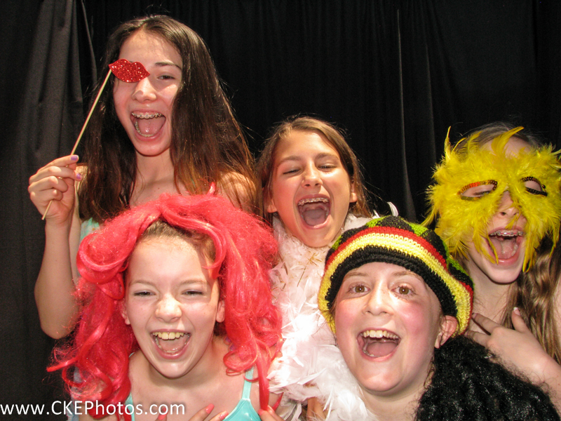 A group of young ladies celebrate 11 year-old a friend's birthday party inside the Curtis Knight Entertainment Photobooth in Billerica, MA
