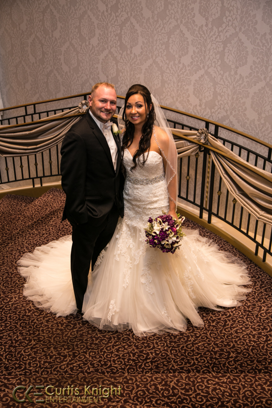 Amanda and Mark Boland pose together on the steps for an exquisite picture!