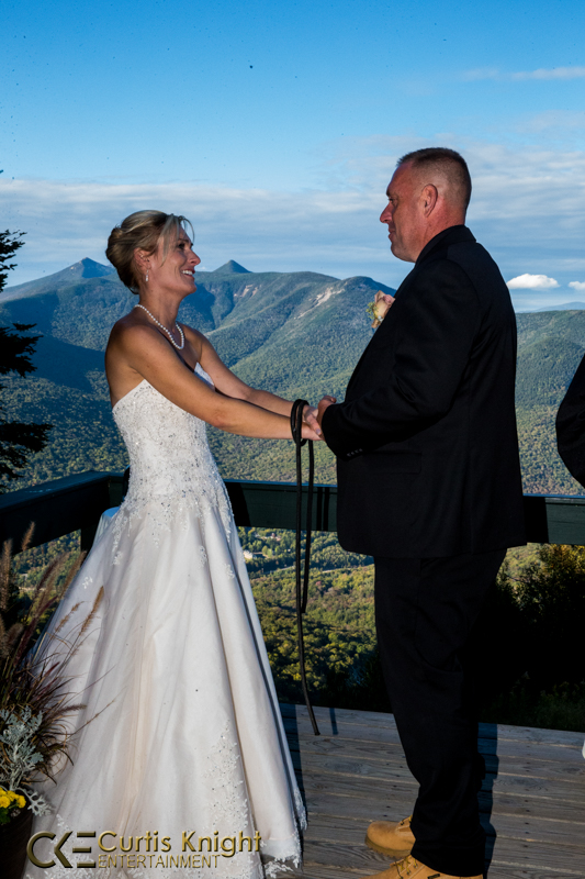 Danielle and Bryan Duby stare into each others' eyes as they are about to be married atop a beautiful mountain!