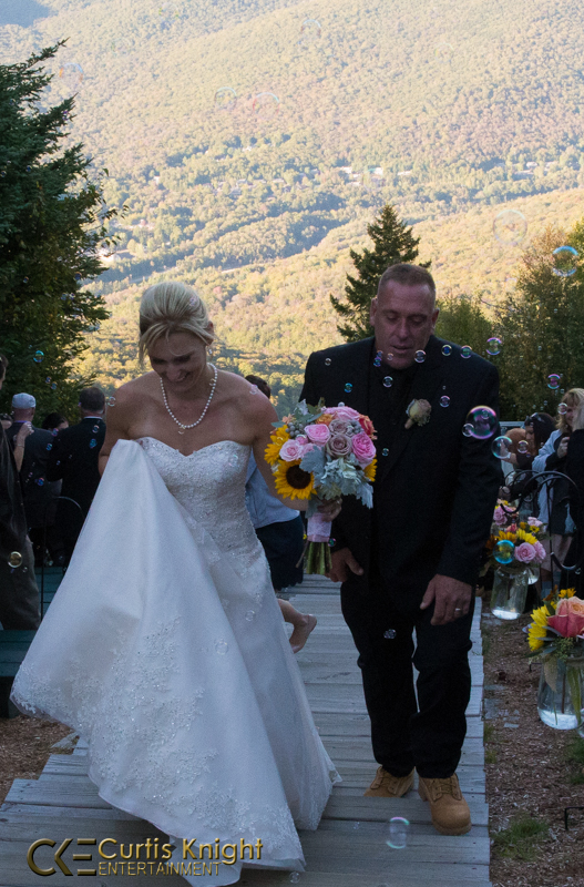 Danielle and Bryan Duby walk back down the aisle together as a newly married couple!