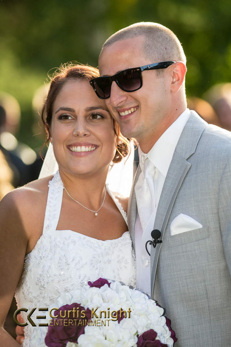 Heather and Eric McLaughlin come together and smile as they are just married!