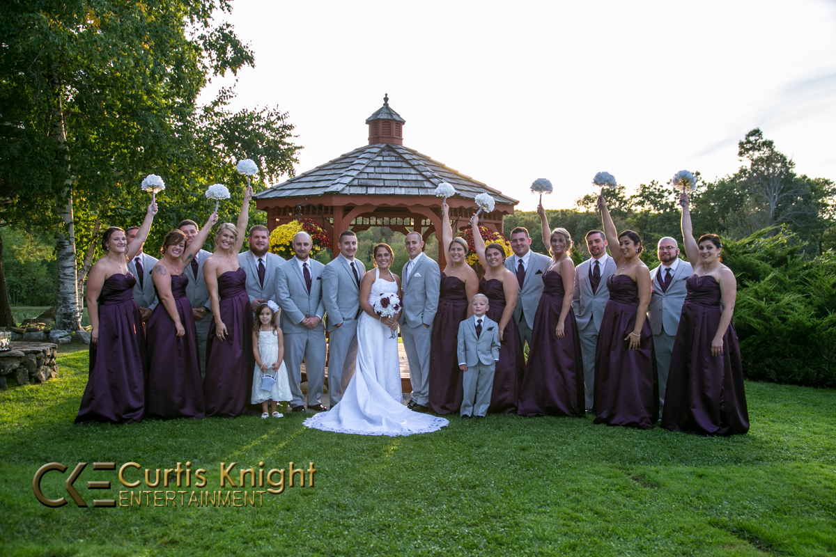 A beautiful wedding starts to come to a close as the bride, groom, bridesmaids, and groomsmen come together to celebrate!