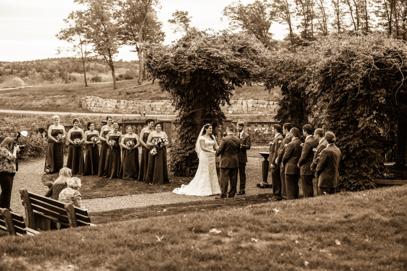 Outdoor wedding ceremony showing Bride Groom , JP, Bridesmaids and Groomsmen.