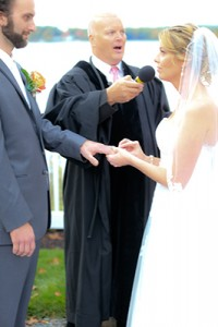 JP Curtis Knight Holds microphone to Michael and Michelle's mouths as they take their vows during a Ceremony.