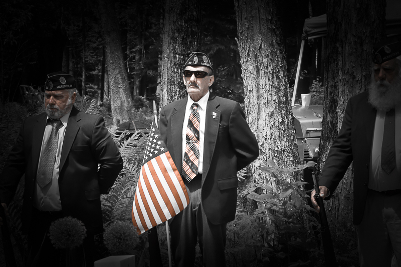 Celebration of life for a fallen soldier.Representatives from Meredith NH VFW stand with rifles at ease, after firing 3 shots in military tribute