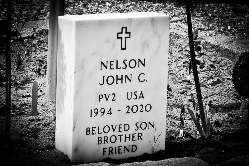 Celebration of life for a fallen soldier. This photo is a pic of a personally crafted tombstone to honor the fallen soldier.