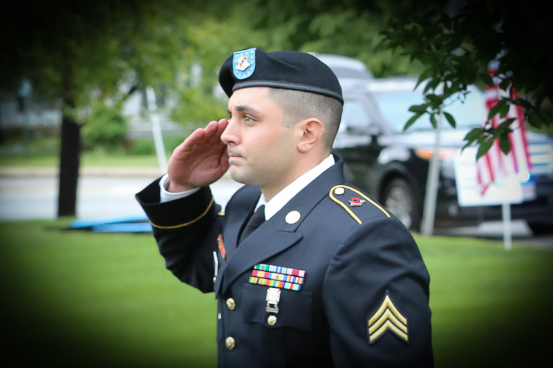 Town of Billerica Memorial Day Celebration. Soldier saluting our flag.